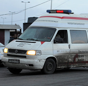 A Syrian red crescent ambulance arrives to evacuate wounded from the area of the Sayyida Zeinab shrine south of Syria's capital Damascus on February 21, 2016, after a series of attacks, targetted the Shiite shrine area