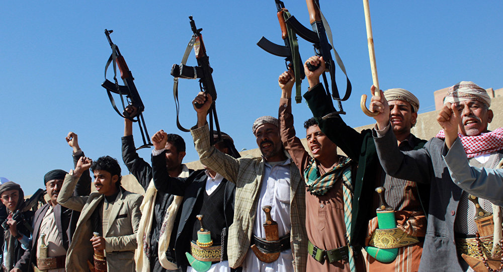 Supporters of Shiite Huthi rebels and militiamen shout slogans raising their weapons during a rally against the Saudi-led coalition, which has been leading the war against the Iran-backed rebels, on December 17, 2015 in Sanaa.