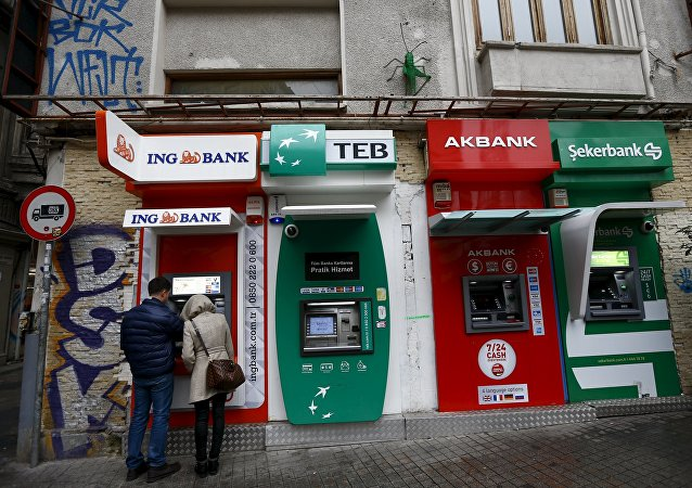 People withdraw money from an ATM at the main shopping and pedestrian street of Istiklal in central Istanbul, Turkey January 30, 2016