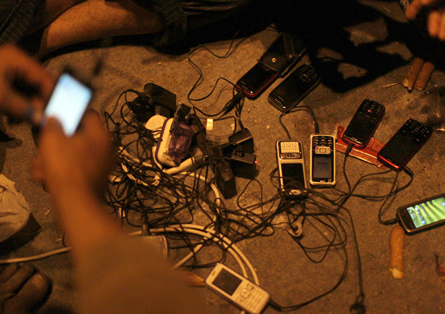 Egyptian protesters charge their cell phones.