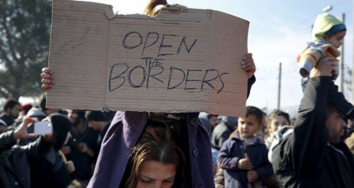 Refugees, stranded for several days, take part in a protest at the Greek-Macedonian border as they wait for the border crossing to reopen near the Greek village of Idomeni February 27, 2016