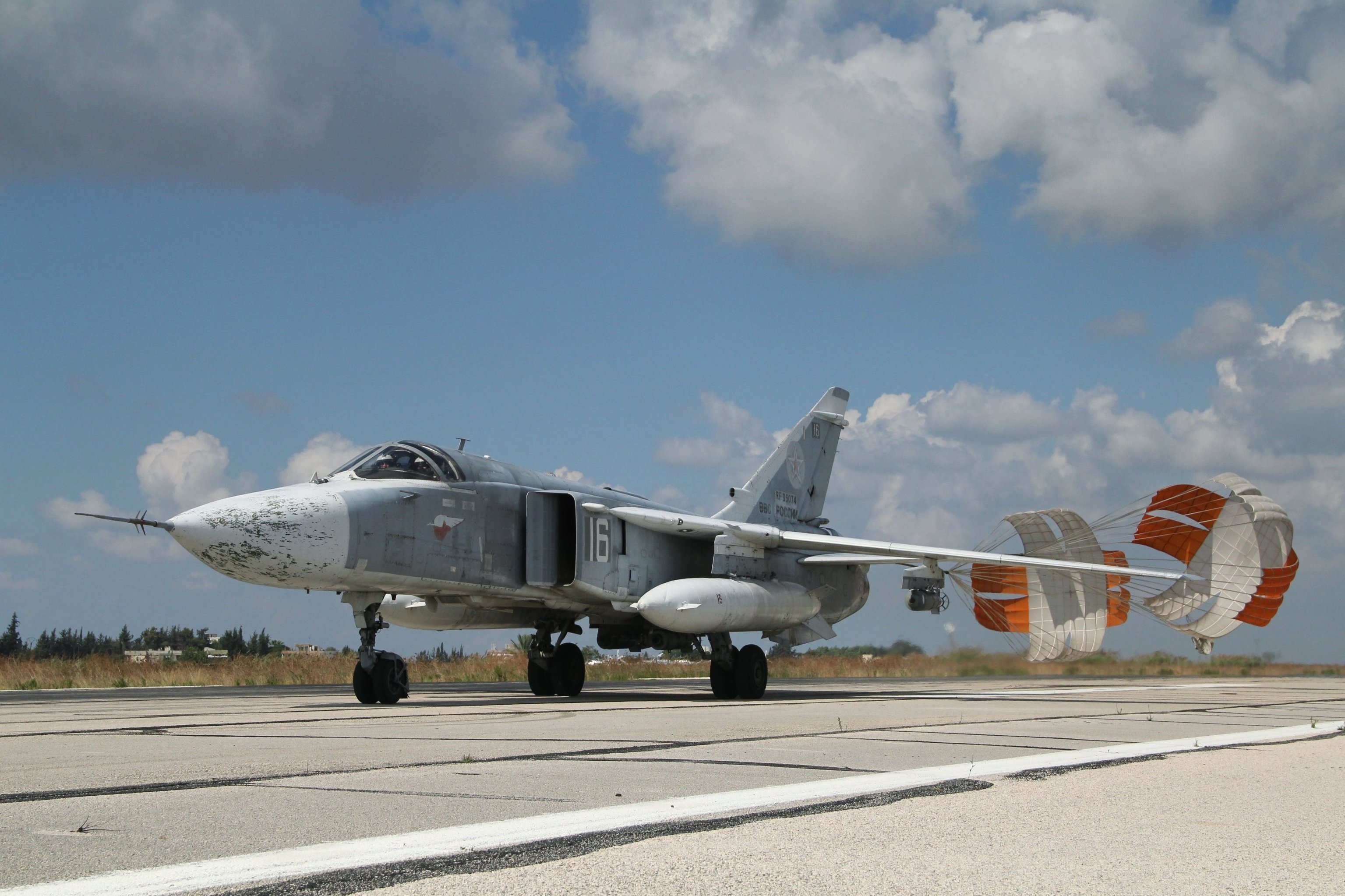 A Russian Su-24 front-line bomber jet lands at Latakia airport, Syria