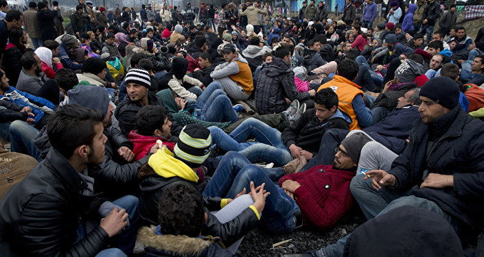 Protesting refugees and migrants block the railway tracks at the Greek-Macedonia border near the northern Greek village of Idomeni, the Sunday, Feb. 28, 2016