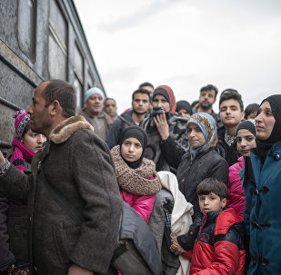 Migrants and refugees board a train heading to to Serbia after crossing the Greek-Macedonian border near Gevgelija on February 18, 2016.