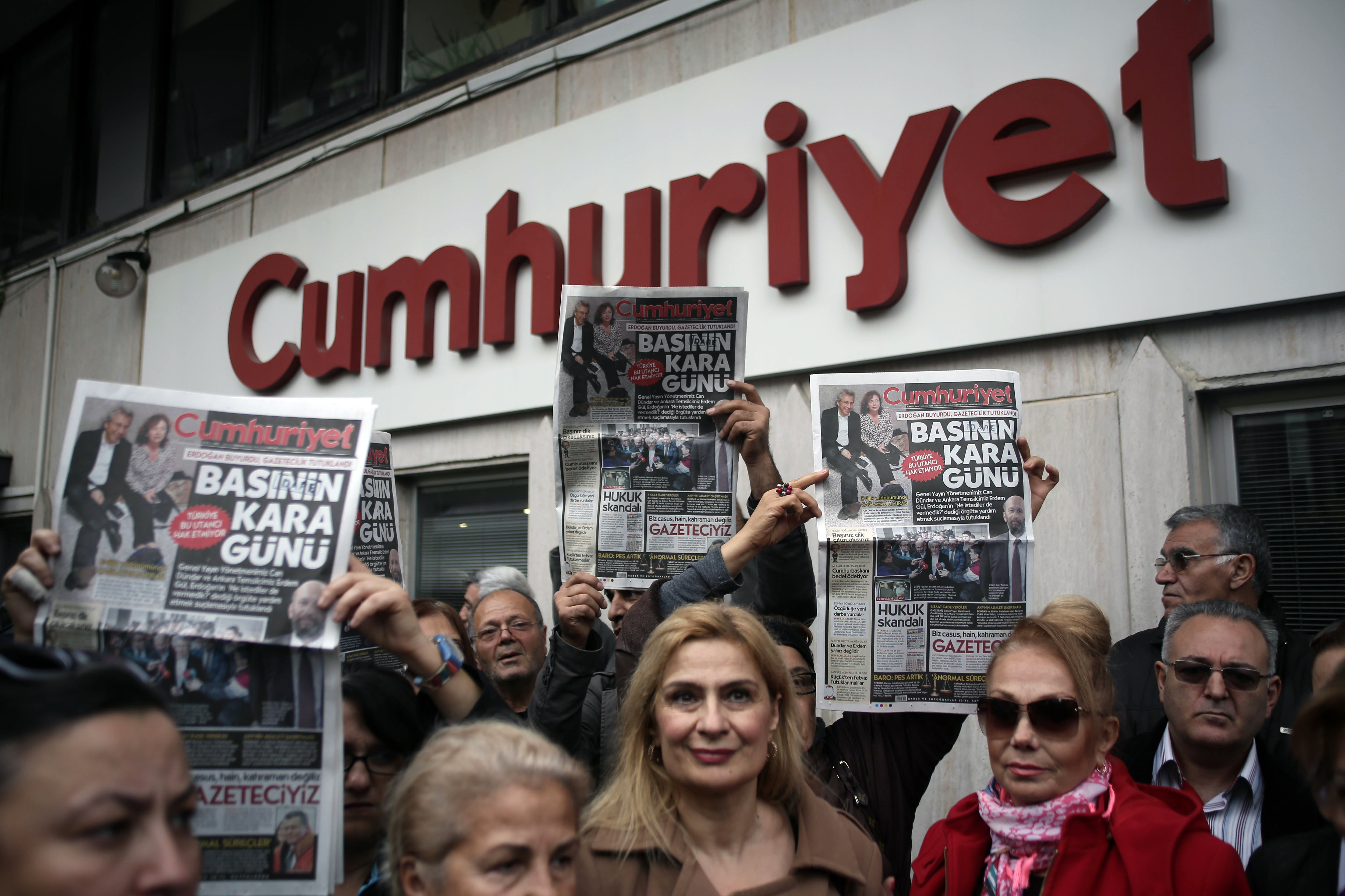 People gather to protest the jailing of opposition Cumhuriyet newspaper's editor-in-chief Can Dundar and Ankara representative Erdem Gul, in Istanbul, Turkey, Friday, Nov. 27, 2015