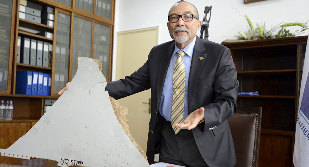 The head of Mozambique's Civil Aviation Institute, Comandante Joao Abreu, shows a piece of debris found on a beach that could be from a missing Malaysia Airlines flight MH370, in Maputo, March 3, 2016