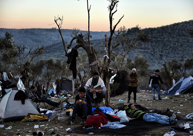 Refugees and migrants live at a field outside the Moria Hot Spot on the Greek Lesbos island on November 12, 2015