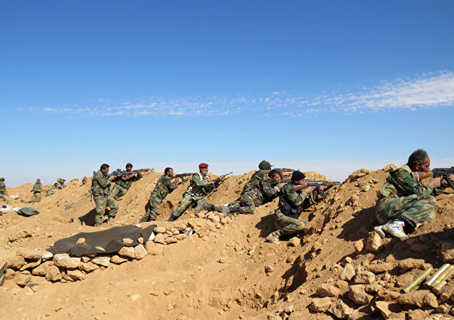 Syrian Army soldiers take positions on the outskirts of Syria's Raqqa region on February 19, 2016