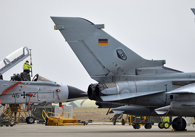 A technician works on a German Tornado jet at the airbase in Incirlik, Turkey, on January 21, 2016