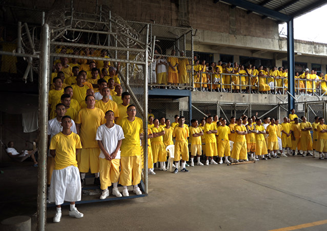 Members of the Mara 18 gang, attend a mass at the Izalco Penitenciary in the city of Izalco, 70 Km west of San Salvador on April 13, 2012