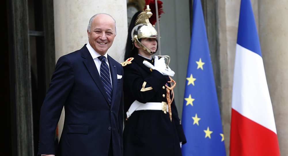 Former French foreign minister Laurent Fabius leaves the Elysee Palace in Paris, after he took the oath as new President of the French Constitutional Council, on March 8, 2016
