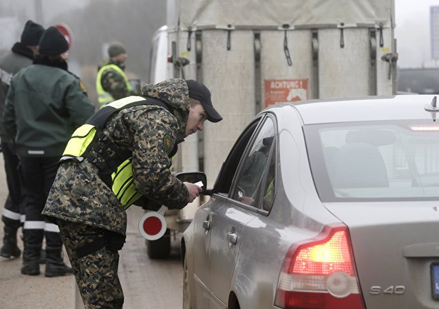 Lithuanian border guards perform check on cars at the border with Latvia near Zarasai, Lithuania, March 8, 2016