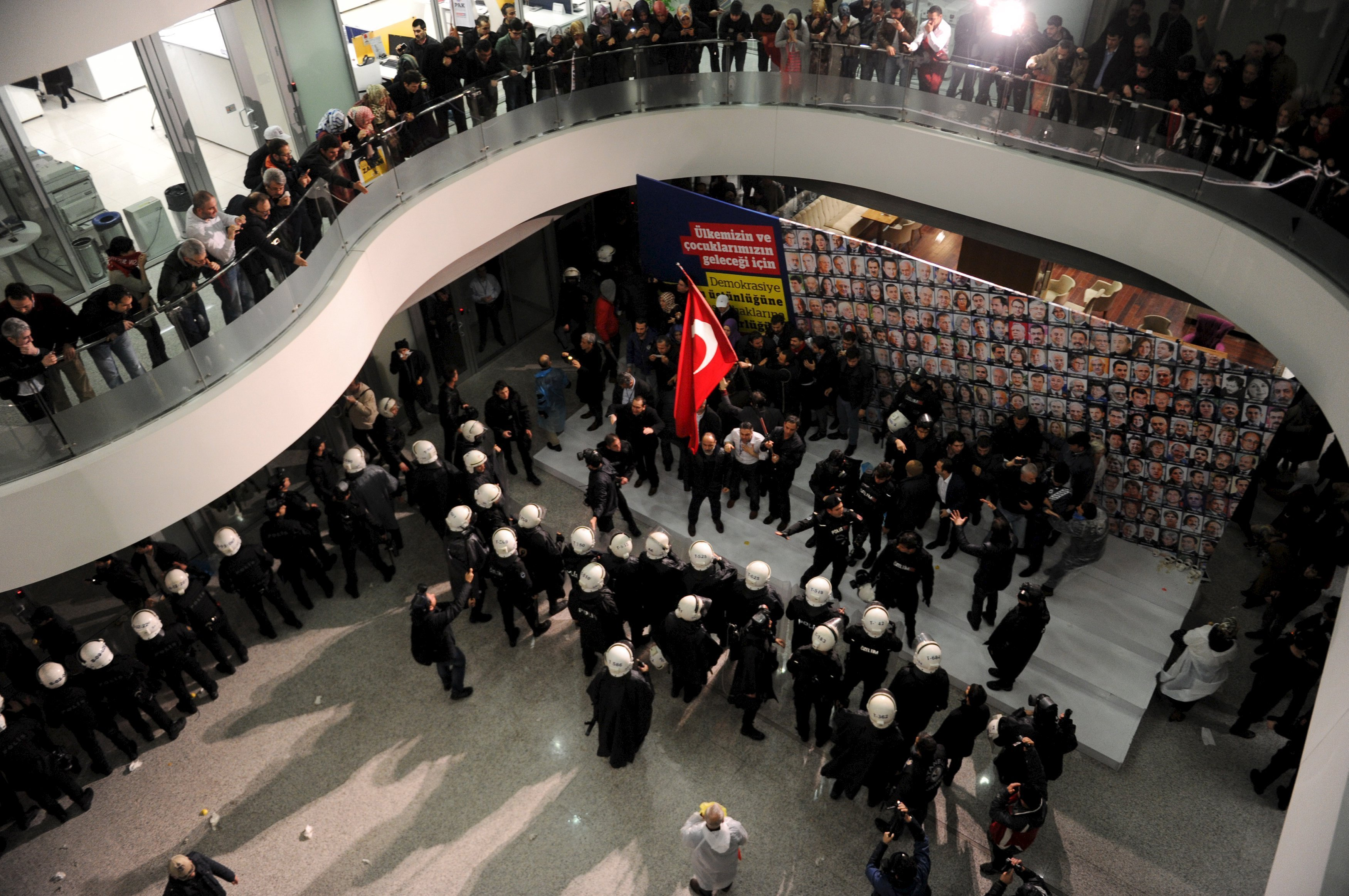 Riot police scuffle with employees at the headquarters of Zaman newspaper in Istanbul, Turkey, late March 4, 2016