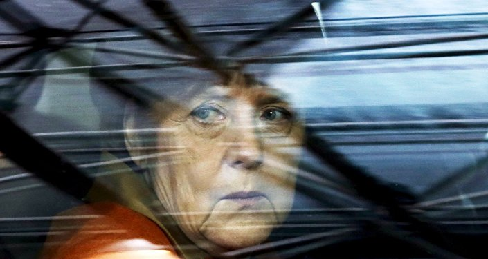 In this file photo Germany's Chancellor Angela Merkel arrives at an EU-Turkey summit in Brussels, as the bloc is looking to Ankara to help it curb the influx of refugees and migrants flowing into Europe, March 7, 2016.