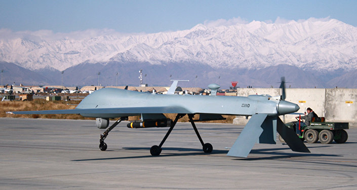 A US Predator Unmanned Drone Armed With Missile Setting Off From Its Hangar At Bagram