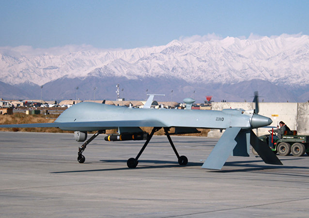 A US Predator unmanned drone armed with a missile setting off from its hangar at Bagram air base in Afghanistan. File photo