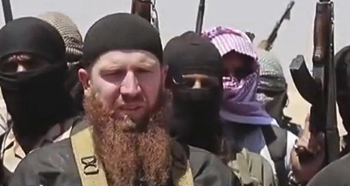 Omar al-Shishani standing next to the group's spokesman among a group of fighters as they declare the elimination of the border between Iraq and SyriaDaesh leader Abu Omar al-Shishani. (File)