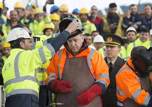 Turkey's President Tayyip Erdogan prepares for the welding of the final section of the Yavuz Sultan Selim Bridge, the Third Bosphorus Bridge, during a ceremony in Istanbul, Turkey, March 6, 2016