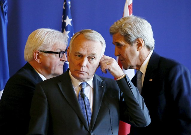 French Foreign Minister Jean-Marc Ayrault (C), U.S. Secretary of State John Kerry (R) and German Foreign Minister Frank-Walter Steinmeier attend a news conference after meeting over the crisis in the Mideast, at the Quai d'Orsay ministry in Paris, France, March 13, 2016