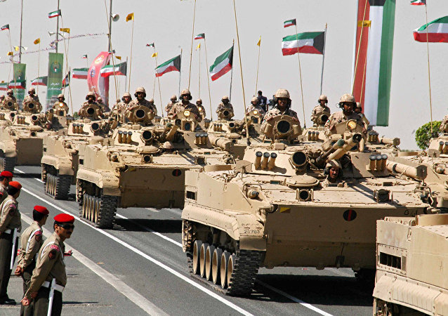 Kuwaiti armed forces sit on top of their tank during a military parade attended by the Emir of Kuwait Sheikh Sabah al-Ahmad al-Jaber al-Sabah in Kuwait City, 07 March 2007