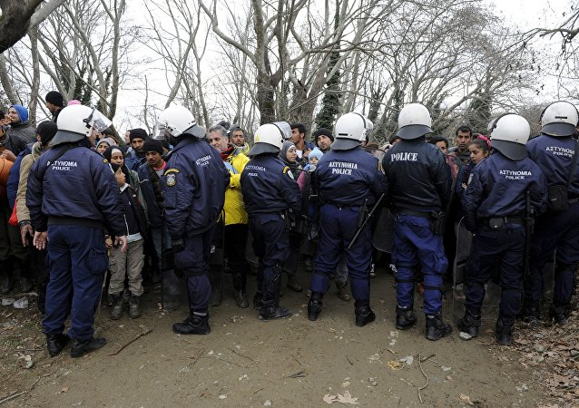 Migrants are stopped by Greek riot police as they look for a way to cross the Greek-Macedonian border, near the village of Idomeni, Greece, March 14, 2016