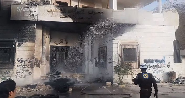 Burnt headquarters of al-Nusra Fron in Maarat al-Numa