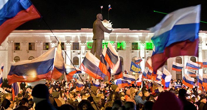 People celebrate in Lenin Square, in Simferopol, Ukraine, Sunday, March 16, 2014.