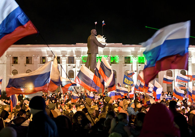People celebrate in Lenin Square, in Simferopol, Ukraine, Sunday, March 16, 2014.