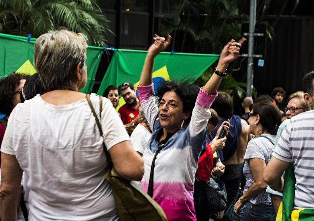 People demonstrate in support of Brazil's President Dilma Rousseff's appointment of Brazil's former President Luiz Inacio Lula da Silva as her chief of staff, at Paulista avenue in Sao Paulo, Brazil