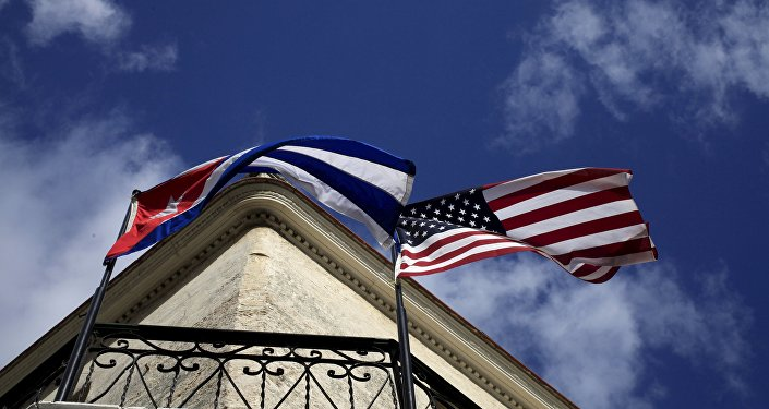 Cuban and US flags are seen on the balcony of a restaurant in downtown Havana, Cuba March 19, 2016.