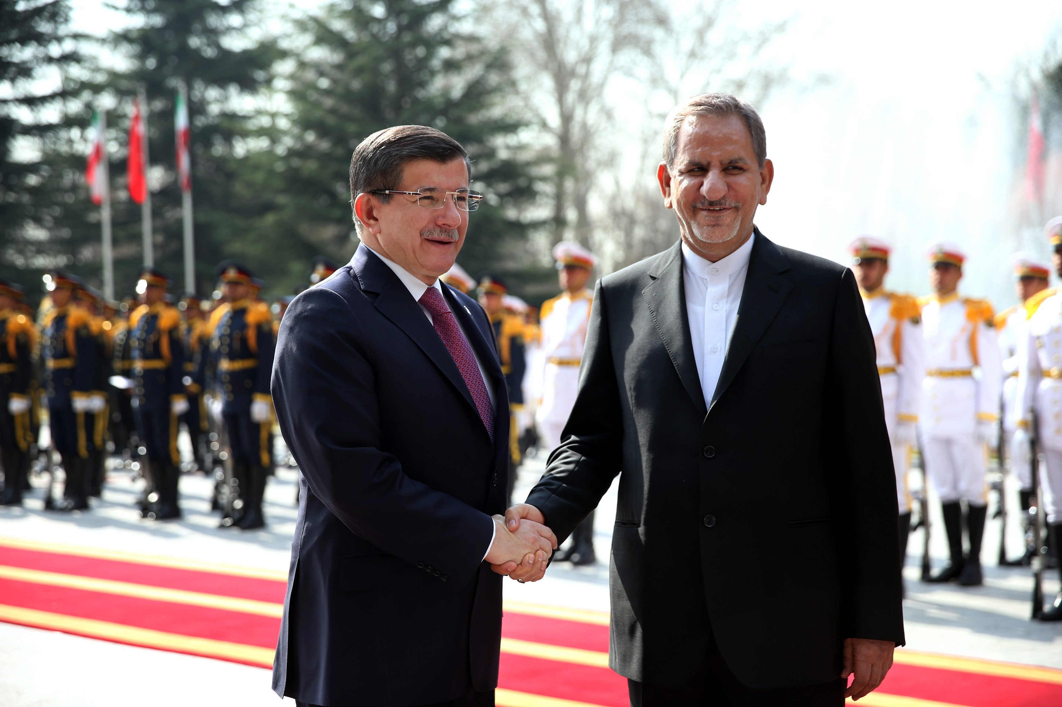 Turkish Prime Minister Ahmet Davutoglu, left, shakes hands with Iranian Vice-President Eshagh Jahangiri during his official welcoming ceremony at the Saadabad Palace in Tehran, Iran, Saturday, March 5, 2016