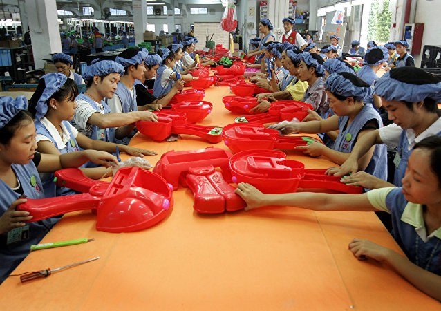Workers assemble toy cars at the production line of Dongguan Da Lang Wealthwise Plastic Factory in Dongguan, China. (File)