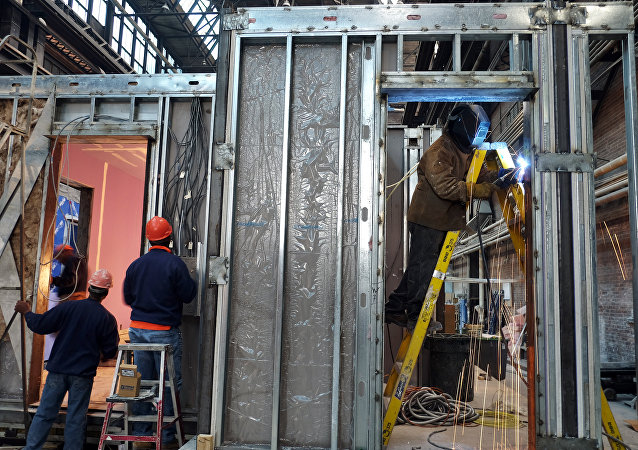 Workers build a modular apartment unit at a Capsys Corp's factory in Brooklyn, New York
