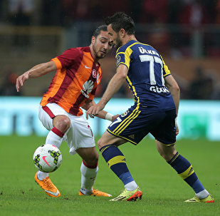 Galatasaray's Tarik Camdal, left, and Gokhan Gonul of Fenerbahce fight for the ball during their Turkish League soccer derby match at the TT Arena stadium in Istanbul, Turkey. (File)