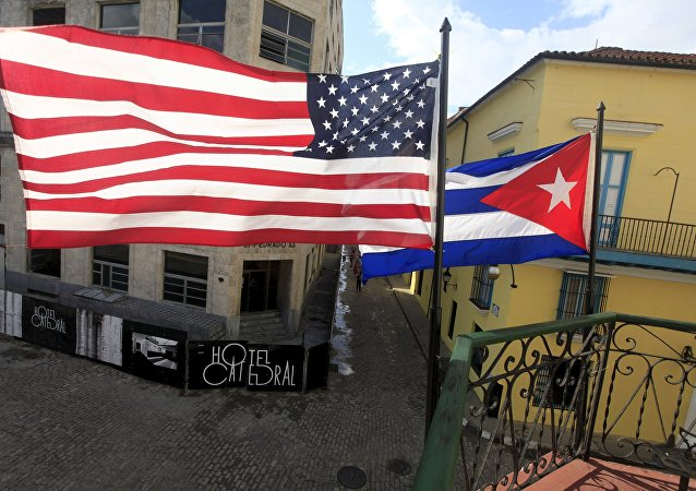 US and Cuban flags are seen on the balcony of a restaurant in downtown Havana, Cuba March 19, 2016.