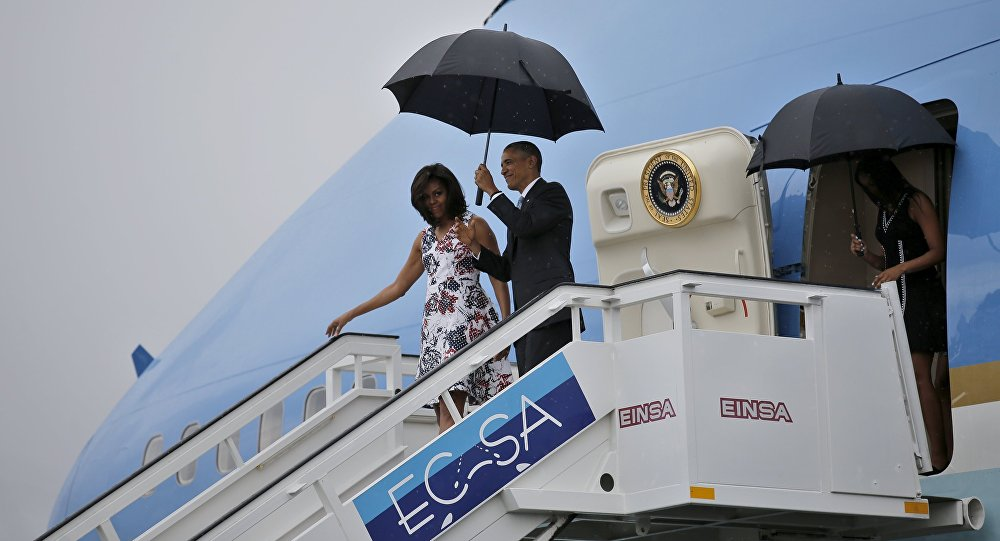 President Barack Obama and his wife Michelle exit Air Force One as they arrive at Havana's international airport for a three-day trip, in Havana March 20, 2016