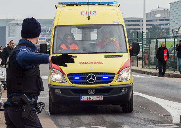Ambulances arrive to the scene at Brussels airport, after explosions rocked the facility in Brussels, Belgium, Tuesday March 22, 2016