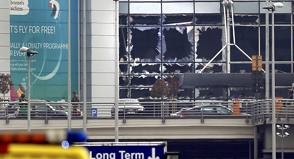 Broken windows seen at the scene of explosions at Zaventem airport near Brussels, Belgium, March 22, 2016
