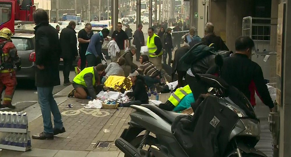 Rescue workers treat victims outside the Maelbeek metro station after a blast, in Brussels, Belgium, in this image taken from a March 22, 2016 video