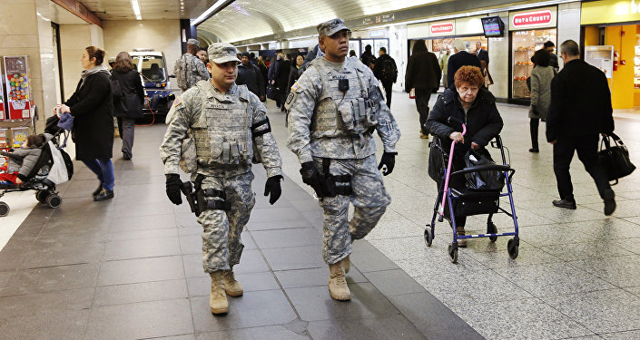 Members of the New York National Guard patrol Penn Station, Tuesday, March 22, 2016, in New York