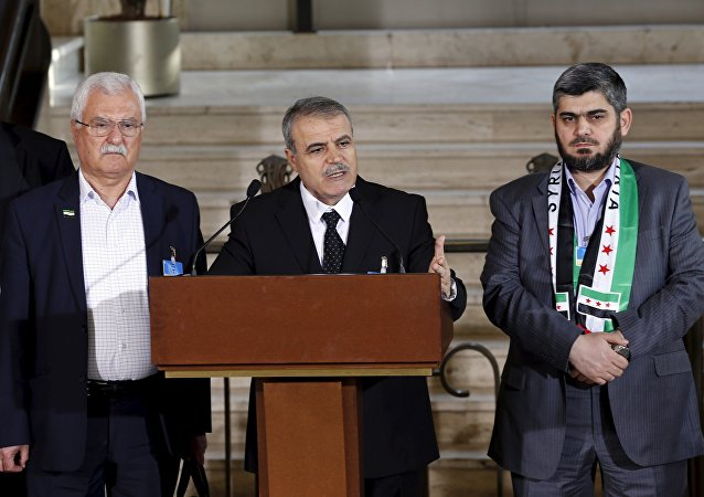 Asaad Al-Zoubi attends a news conference next to Mohamed Alloush of the Jaysh al Islam and George Sabra members of the High Negotiations Committee (HNC) after a meeeting with U.N. mediator Staffan de Mistura during Syria peace talks at the United Nations in Geneva, Switzerland, March 22, 2016