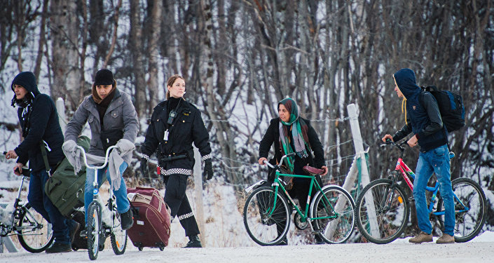 Refugees walk alongside there bikes in polar Russia