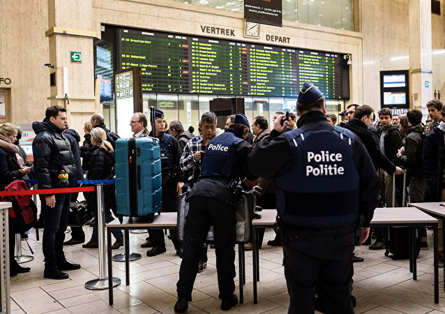 Police search passenger bags at the Central Station in Brussels on Wednesday, March 23, 2016