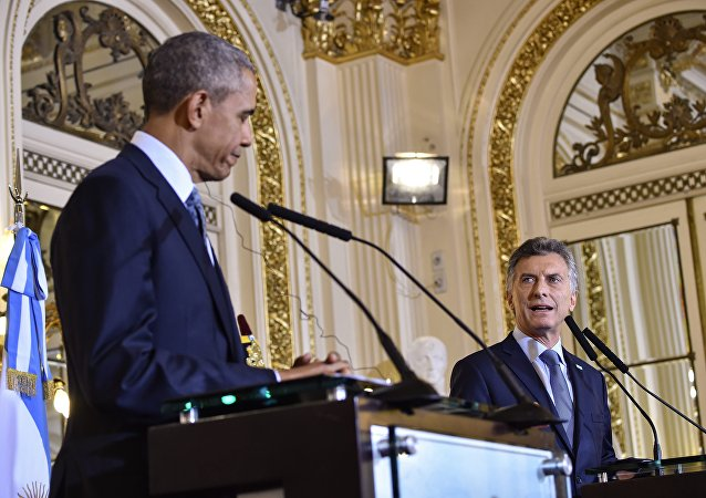 US President Barack Obama (L) and Argentinian President Mauricio Macri deliver a joint press conference at the Casa Rosada presidential palace in Buenos Aires on March 23, 2016