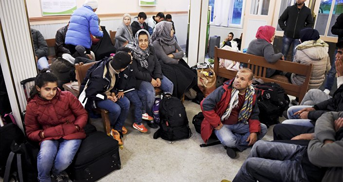 Iraqi refugees wait for a train to Helsinki at Kemi railway station in northwestern Finland, on September 17, 2015