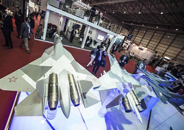 Models of the T-50, left, and Su-35 Russian fighter jets at the Rosoboronexport stand during the 2015 Dubai Airshow international exhibition