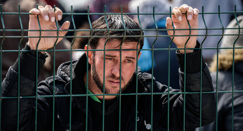 A migrant waits at a Turkish coast guard station at the Dikili district in Izmir, on March 20, 2016 after being catched with other migrants while trying to reach the Greek island of Lesbos from the Bademli village, western Turkey.
