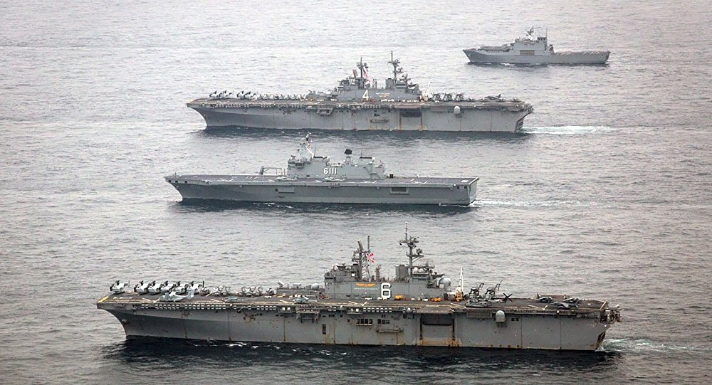 The U.S. Navy amphibious assault ships USS Bonhomme Richard, bottom, and USS Boxer, second from top, are underway with the Republic of Korea Navy Dokdo Amphibious Ready Group in the East Sea during exercise Ssang Yong 2016, March 8, 2016