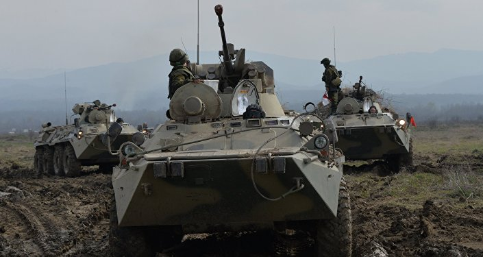 BTR-82A armored vehicles during the battalion tactical field firing exercise of the motorized infantry brigade of the Southern Military District at the Gvardeyets base in Shali district, Chechnya.