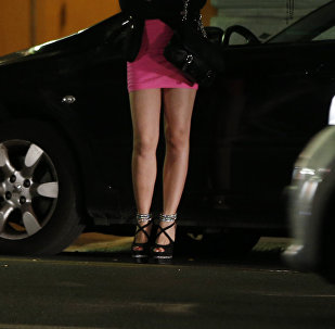A prostitute waits for clients in a street. File.